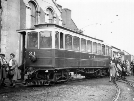 Wartime services on the M.E.R with Car No.21 in 1943, carrying austerity livery with slatted headlight and blackout curtains. © Website Collection