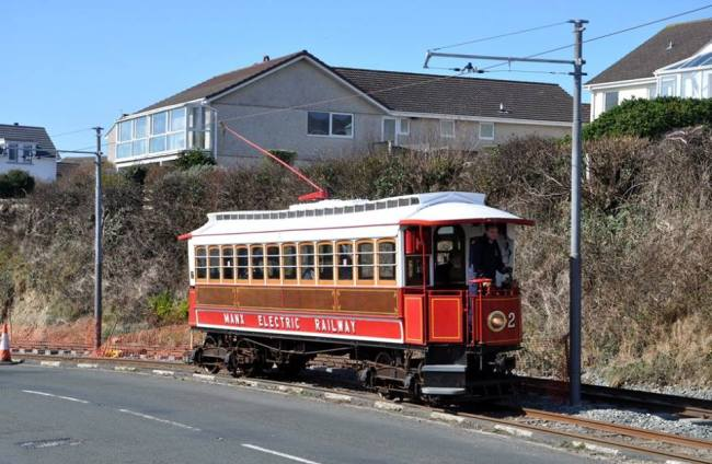 "1893 or 2016? Car 2 working ""wrong road"" past the track renewal works at Harbour Road. The single line and poles with only one bracket arm are reminiscent of the 1893 photographs of the Douglas to Groudle line. © Andrew Scarffe"